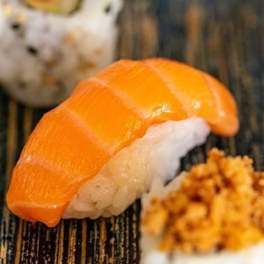 a close up image of a selection of different sushi styles on a plate portrait