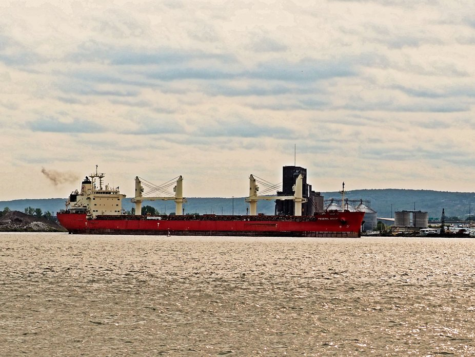 A freighter leaving the port of Duluth, MN loaded with cement. It was getting ready to go under t...