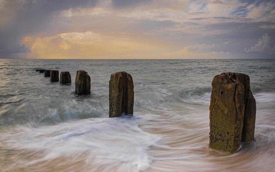 Long exposure photograph of a sunrise on the beach.