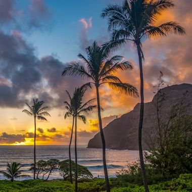 Sunrise at Makapu'u with Lighthouse up on the cliff side.