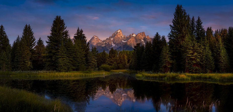 Seconds after dawn, the light just kisses the tops of the Tetons. As a light mist rises from  S...