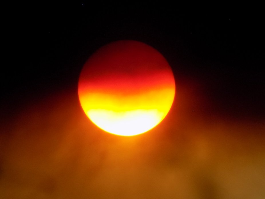 Sun setting during Magnum fire