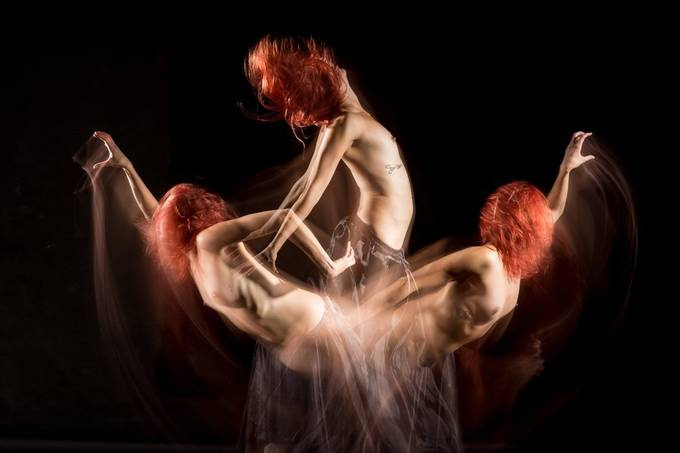 Long exposure during which the flashes were fired three times, resulting in three separate exposures of the dancer (the gifted Aria Rainbow).   20180927 172.JPG