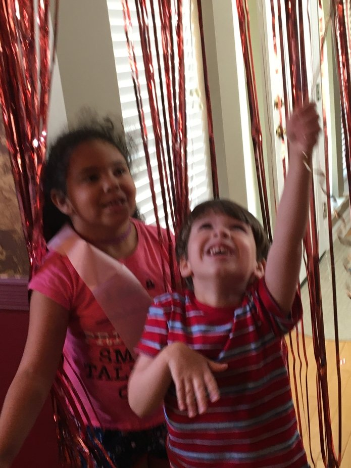 Was my daughters sixth birthday an she an my nephew were just having fun in streamers that day.