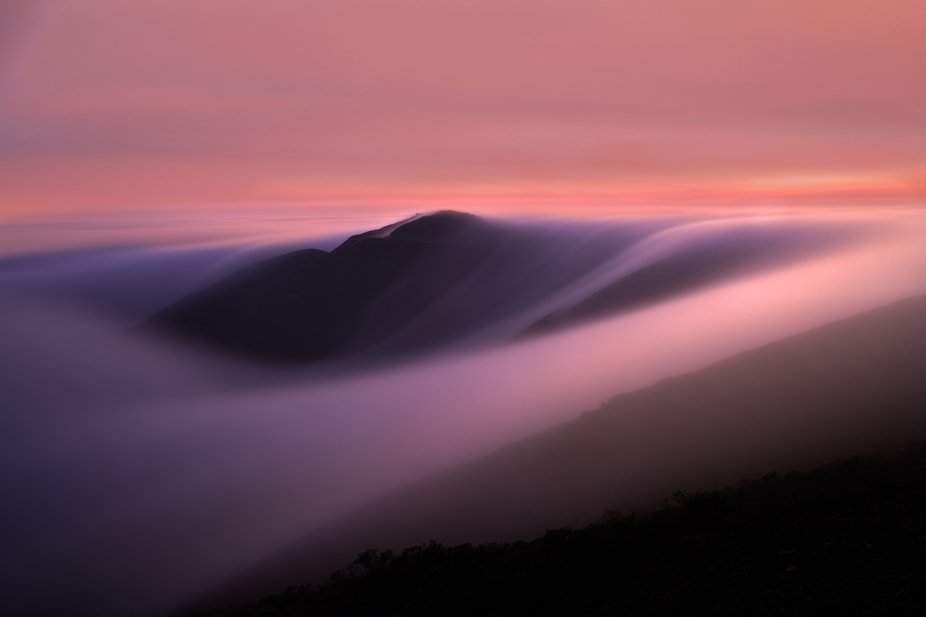Rolling fog over the Marin Headlands in San Francisco, California at sunset.   Karl the fog