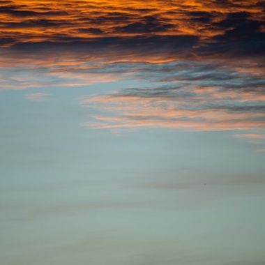 a close up image of golden orange clouds during a sunset in Marbella, Spain