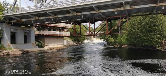 Below dam Under Bridge middle of river