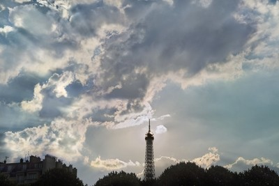 The sun blazing through the top level of the Eiffel Tower
