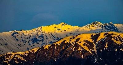 the sun setting on the Himalayan ranges..