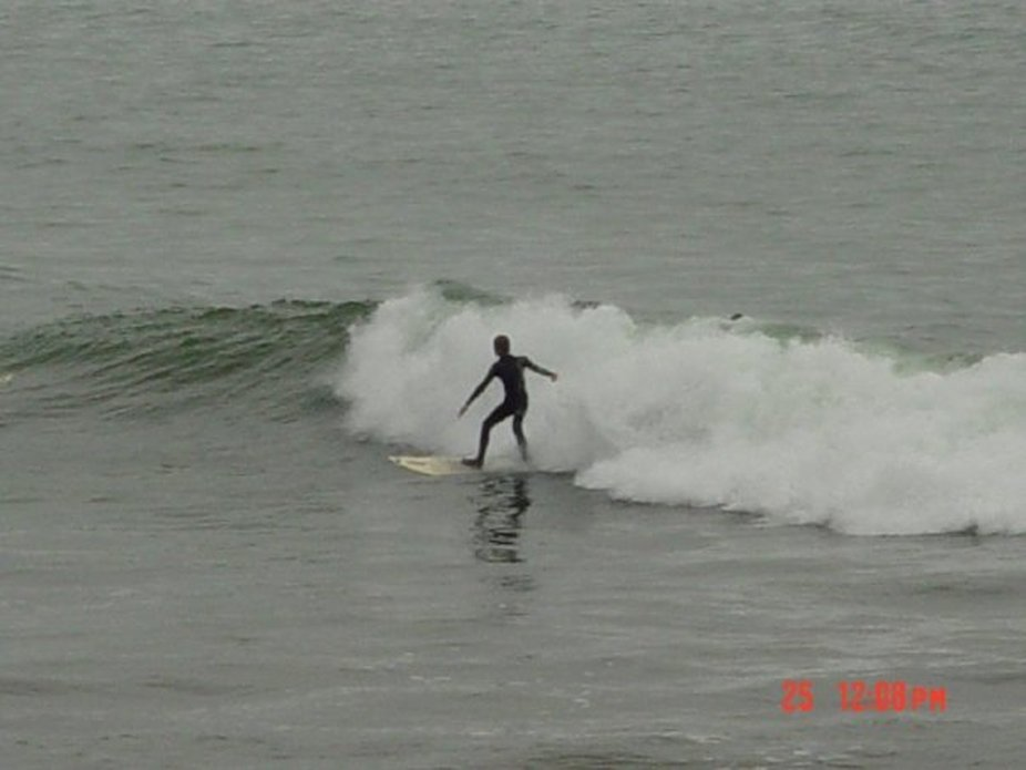 Surfer at Half moon bay california
