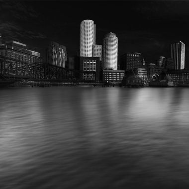 Office buildings at waterfront with reflections