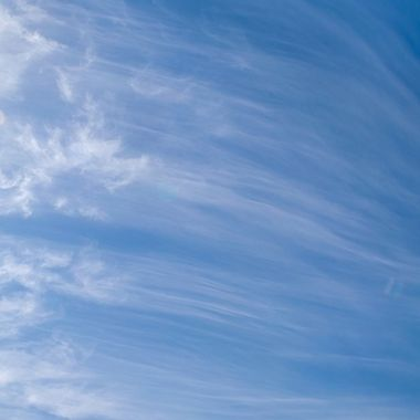 thin white clouds on a blue sky background during summer in Marbella