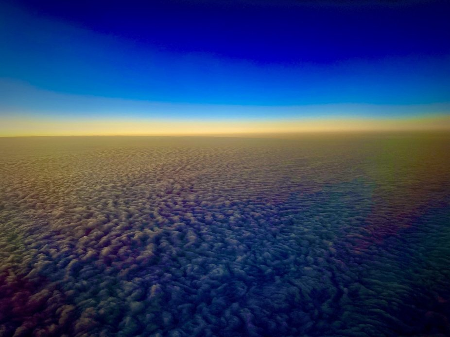 Picture taken from a American Airlines flight above the clouds