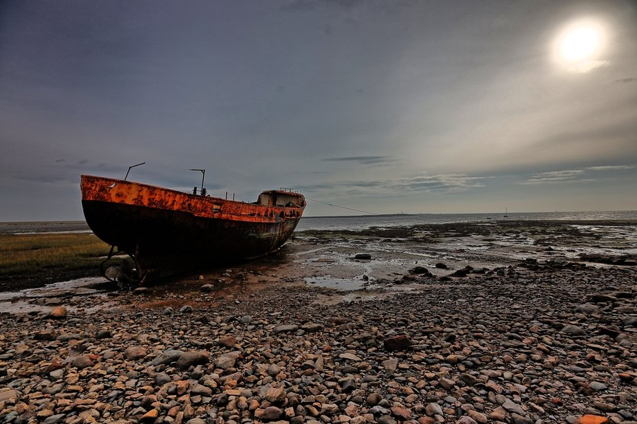 a rusty boat by the causway linking Roa Island to the Furness peninsula