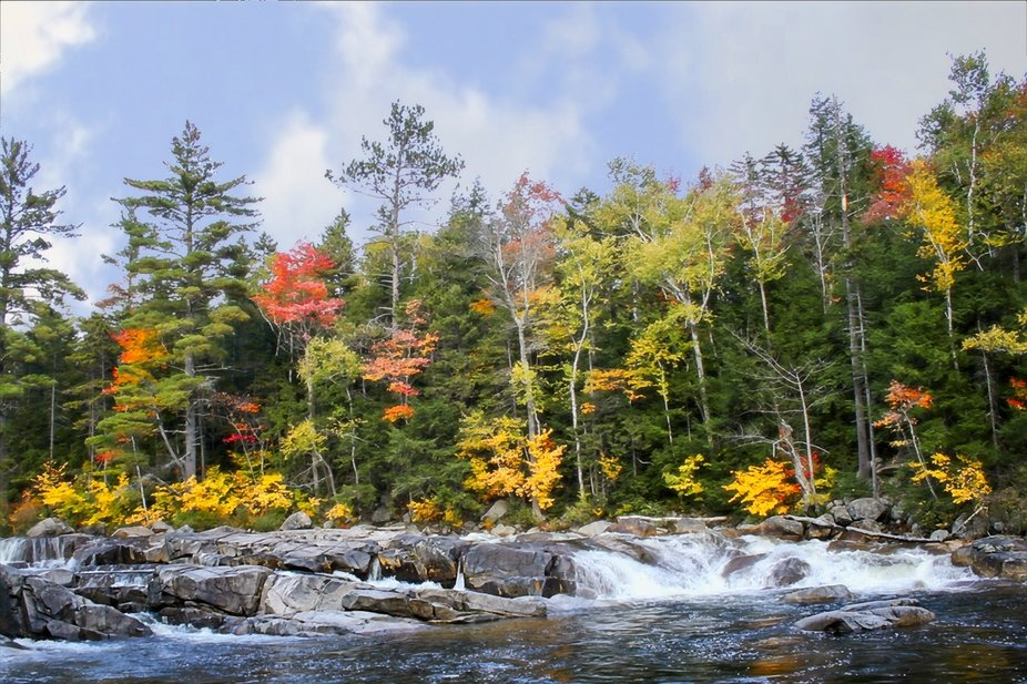 A New Hampshire river flows through the fall colors...