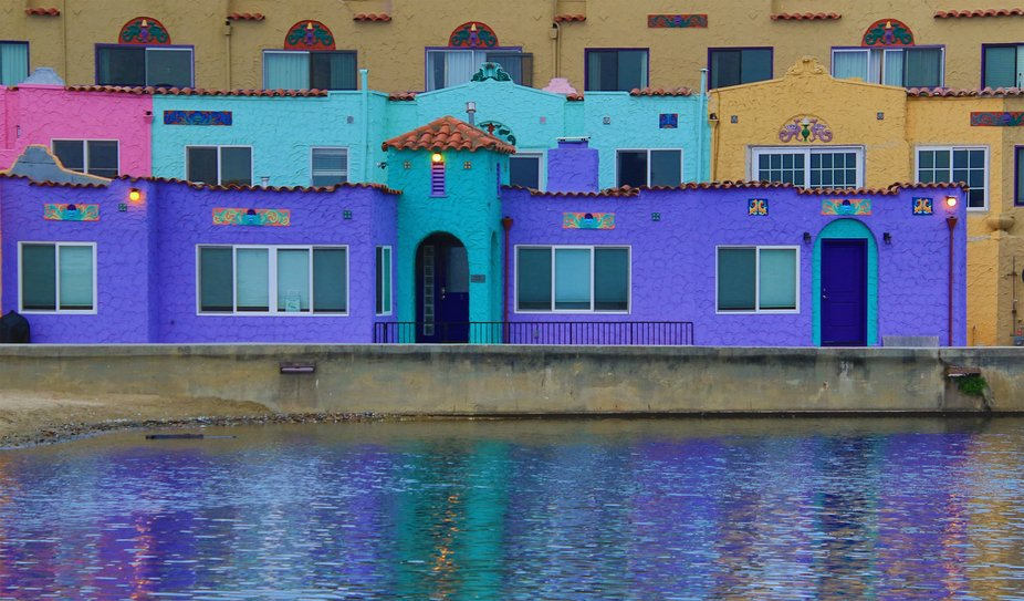Colorful Buildings Reflected in River