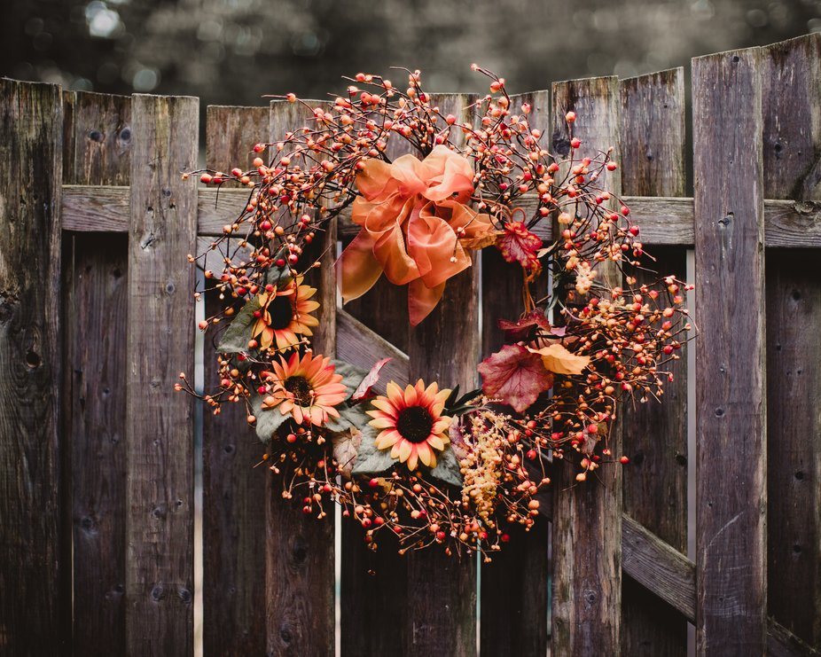 Autumn wreath on a weathered wood gate.