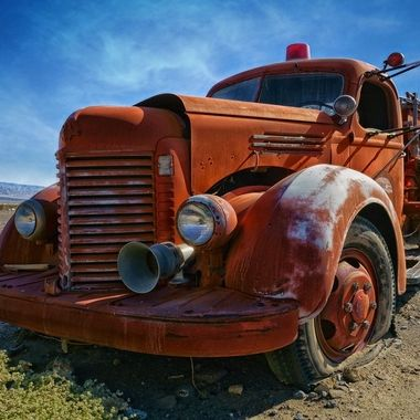An old fire truck sits out in the desert , a testament to times past and extreme weather.