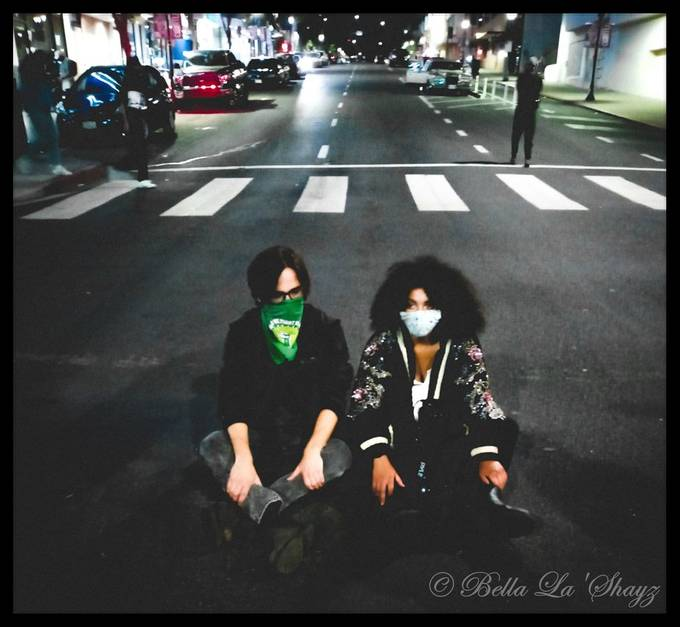 I love this photo for so many different reasons. In the mix of a demonstration these two just decided to sit in the middle of the street.