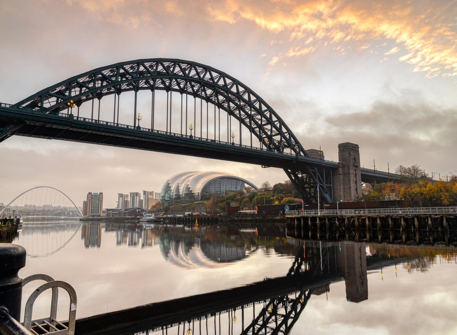 Tyne Bridge shot from the Newcastle Quay side leading over the river Tyne toward Gateshead, the S...