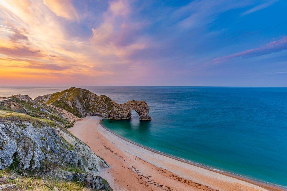 A beautiful sunrise at Durdle Door. Dorset, England