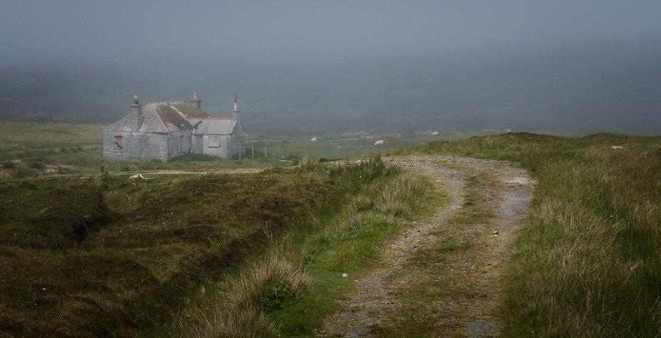 Abandoned croft sitting in the coastal mist, Benbecula, Outer Hebrides