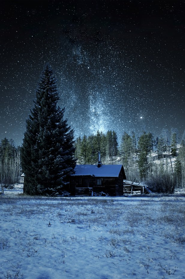 A small cabin in the Colorado Rocky Mountains with an absolutely beautiful view of the mountains and night skies.