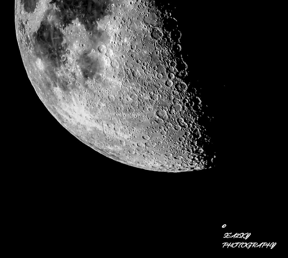 Terminator detail in the first quarter moon.