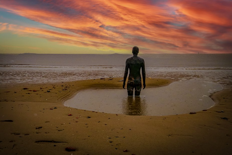 One of Antony Gormley's many sculptures.     A good cover for a vinyl album?