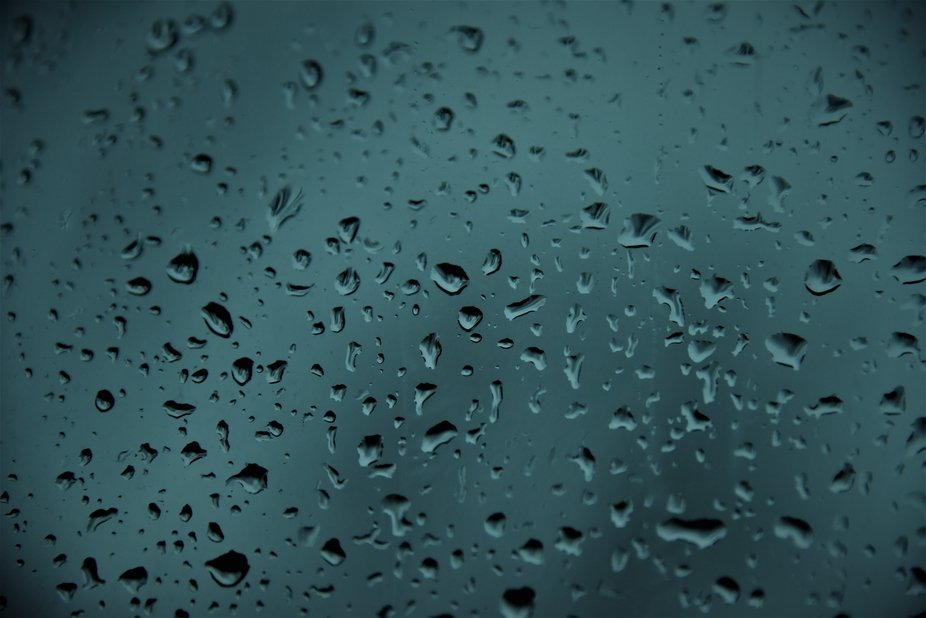 The blue of summer, raindrops on glass