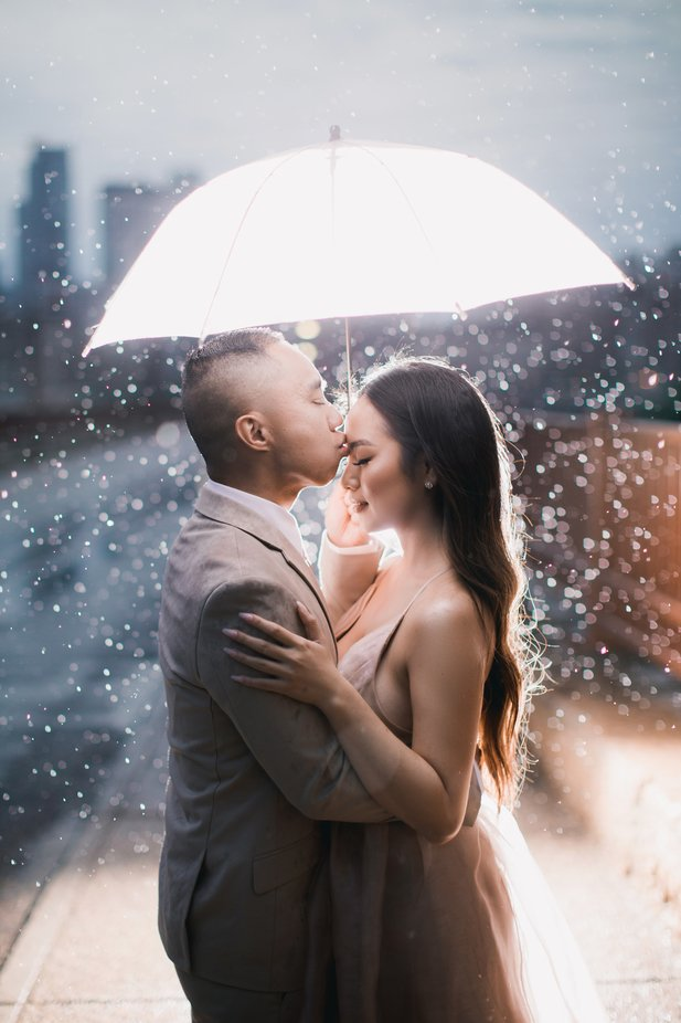 Kiss In The Rain by HouavangPhotography - Wedding Moments Photo Contest