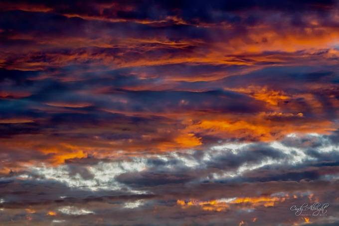 Orange and blue cloud filled sky at sunset