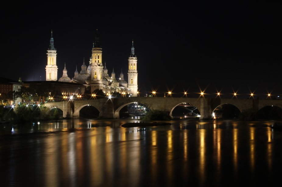 The Basilica of Our Lady of the Pillar and the Stone Bridge. Although the river was not flowing f...
