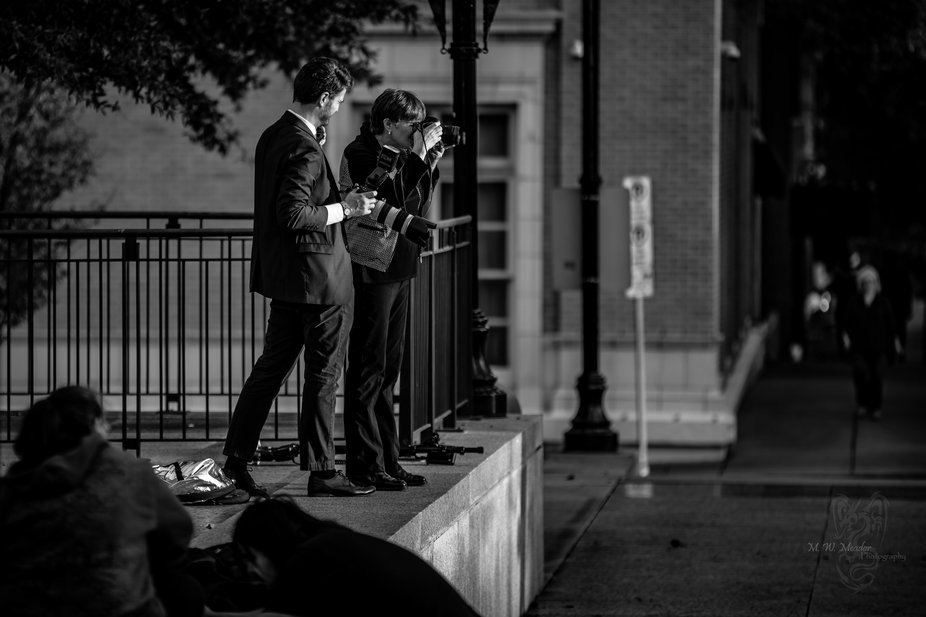 Wedding photographers in action.