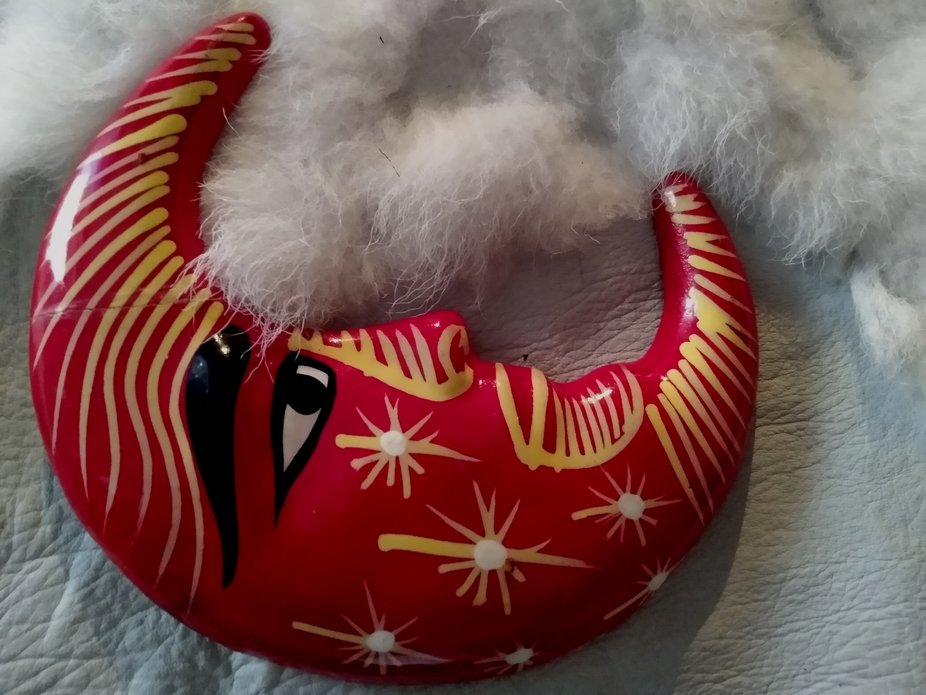 red and gold clay moon on actric fox fur pelt