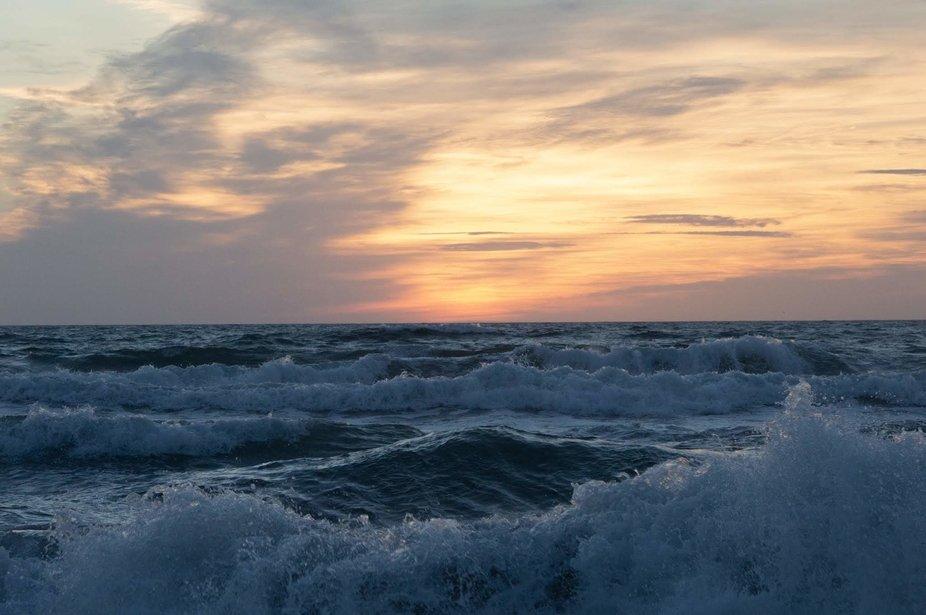 Sunrise on a stormy ocean