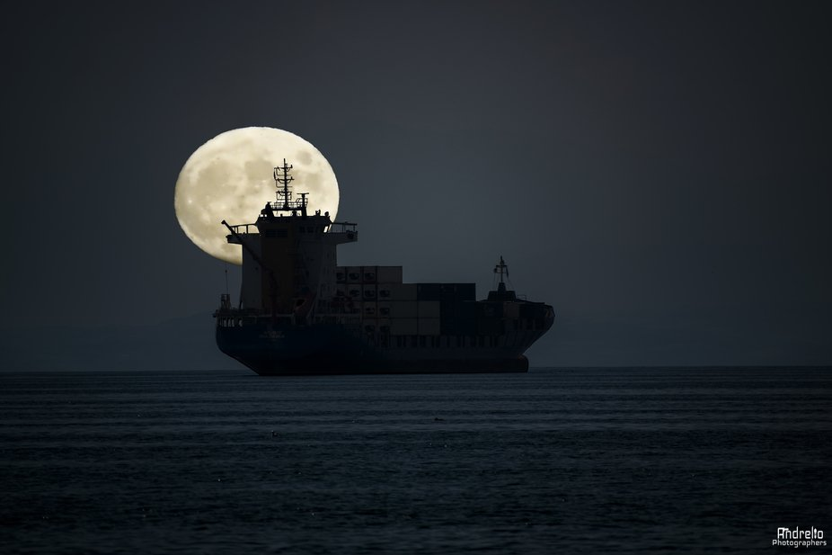 cargo ship in thessaloniki .. a wonderful moment with a full moon background ..