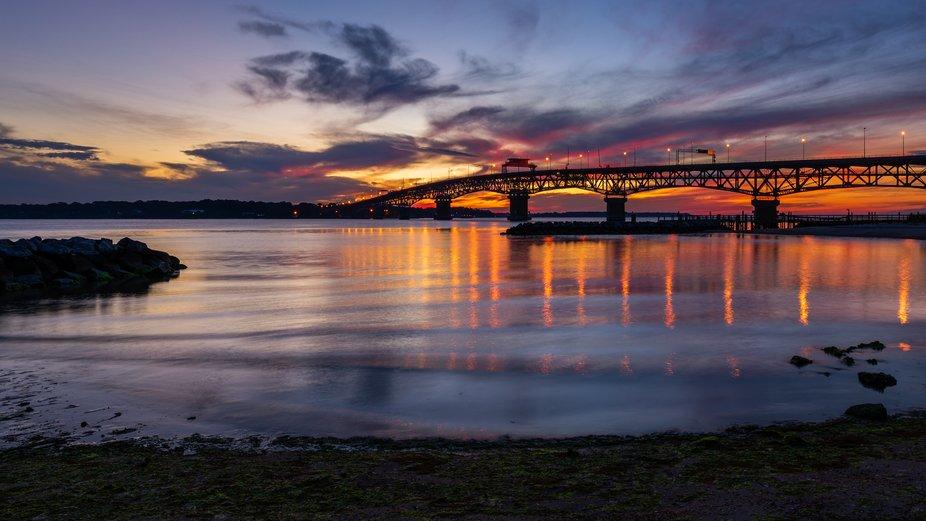 The Coleman Bridge just before sunrise at Yorktown Beach, Virginia.
