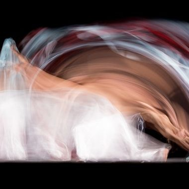 Long exposure shoot with the wonderful dancer Candela Murillo (@kamusa_art). She danced between two permanent honeycombed lights in front of a black background. At the end of the exposure two honeycombed flashes were fired to freeze her final position.