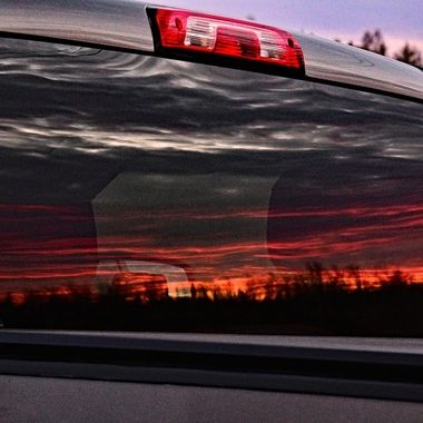 Sunset in the back glass of my truck