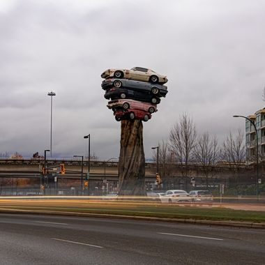 The Trans Am Totem is a public art installation in Vancouver, British Columbia, Canada, created by sculptor Marcus Bowcott. Part of the Vancouver Biennale, the piece was unveiled in April 2015. Located at the intersection of Quebec Street and Milross Avenue, near False Creek, east of Vancouver's Downtown area, the sculpture incorporates stacked cars on top of a base made from a tree trunk.[1] It stands 10 metres (33 ft) high and weighs 11,340 kilograms (25,000 lb)