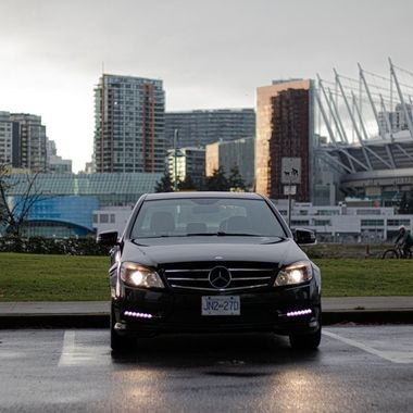 A nice shot of the Mercedes with a casino, stadium and city in the background