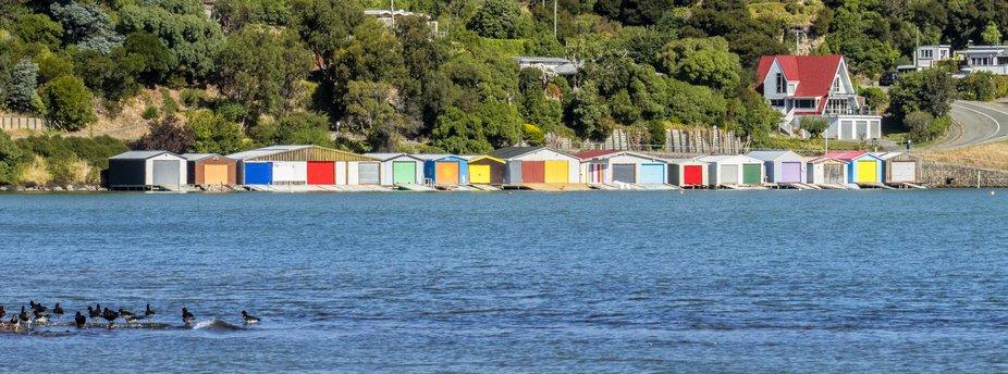 Colourful boatsheds at Duvauchelle, New Zealand.  20 February 2019