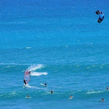 Wind, Kite and Surfing off Diamond Head point, Oahu, Hawaii.
