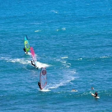 Windsurfing and Surfing off Diamond Head point, Oahu.