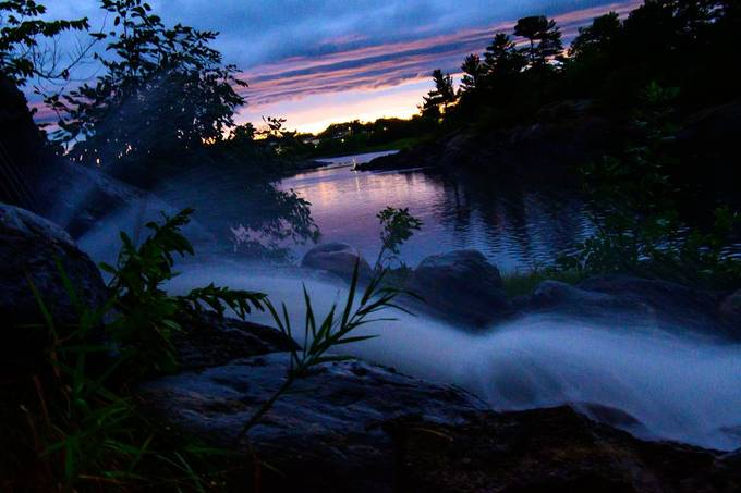 A fast downpour flooded a drain system and created this waterfall that looked like a tropical sunset along the Rainy River
