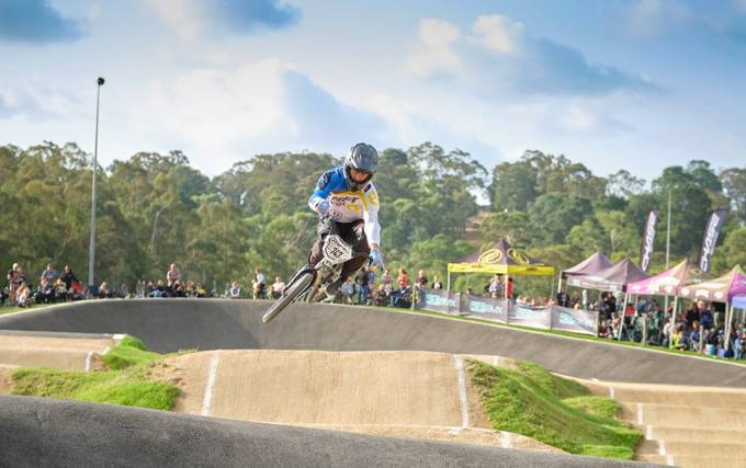 This image captures the feel of Racing at Park Orchards BMX Club in Summer.