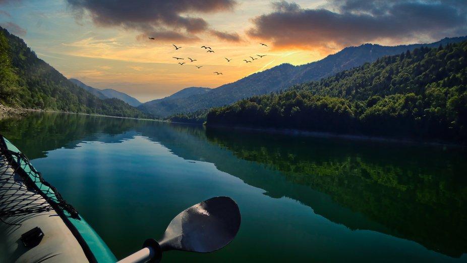 Paddling on the mountain lake.  Taken on Sylvensteinsee, Bayern, Germany.  Digitally edited.