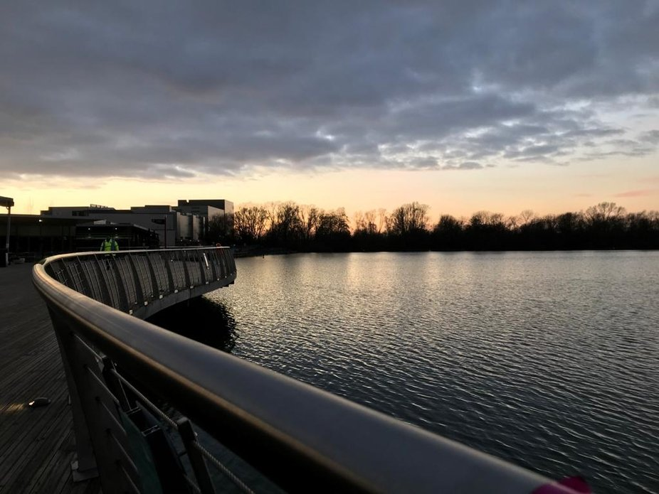 A shot facing the west of Rushden lakes, next to a barrier.