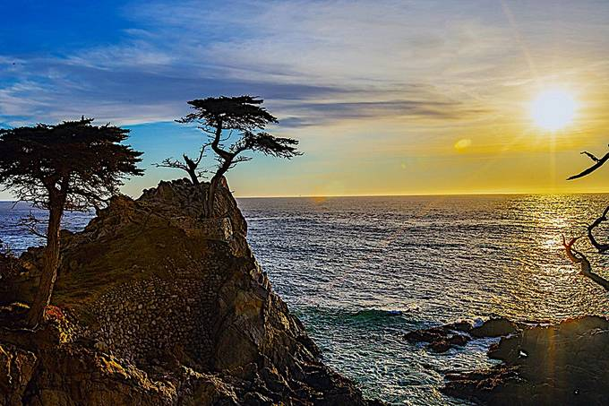 Landmarks Sunset, This beautiful area called  Cypress Point features a Lone Cypress tree, an iconic place Ive only recently photographed. Soebding time finding an area away from the tourist view deck payed of to get this perspective and flare the sun desc